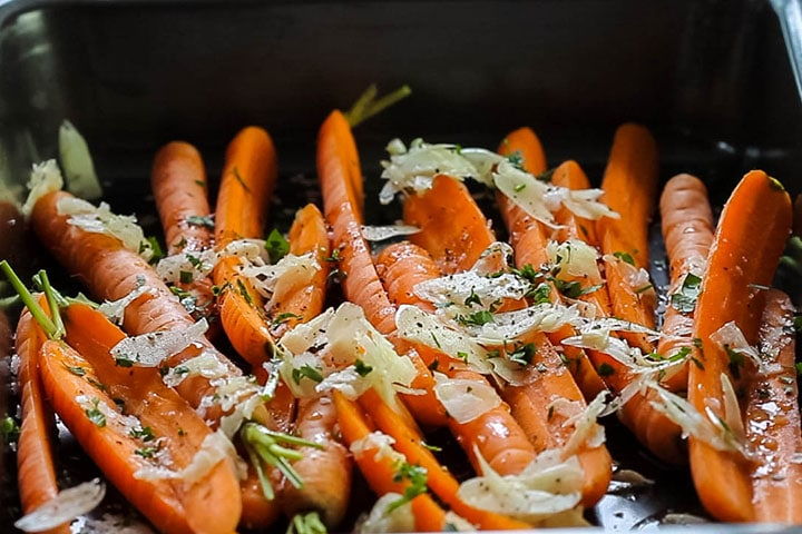 salt, pepper and chopped parsley added to the carrots in the pan