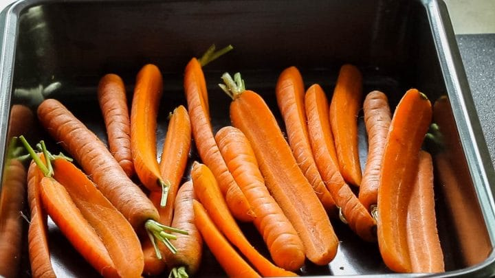 The carrots added to a roasting pan