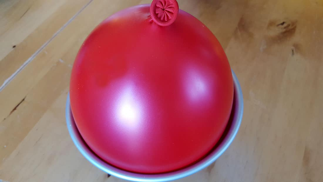 Chocolate Christmas Smash Cake prep two- balloon in a bowl