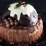 a chocolate Christmas cake shaped like a Christmas pudding