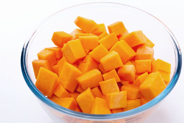 Squash cut into cubes in a clear glass bowl