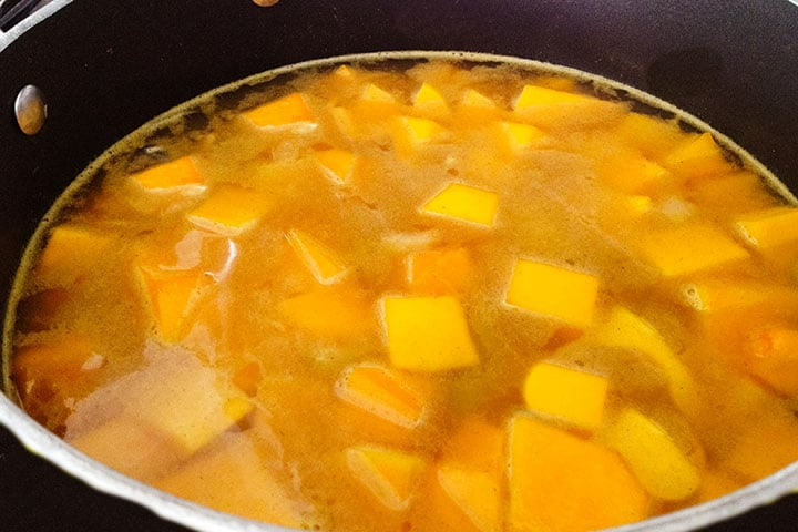The squash and stock added to the pot