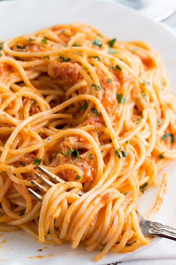 Spaghetti with Skinny Tomato Cream Sauce with a fork twirled into it
