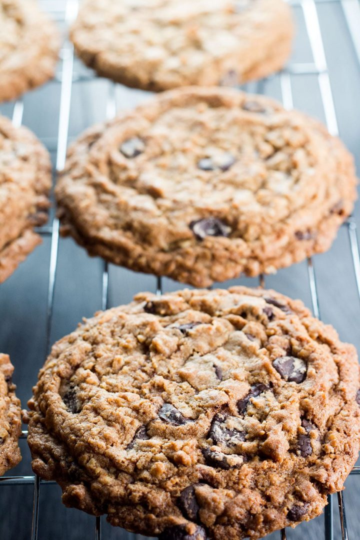 Chocolate Chip Oatmeal Cookies cooking on a cooling rack