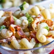 a bowl of pasta salad with bacon