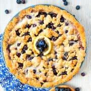 homemade blueberry tart on white wooden surface