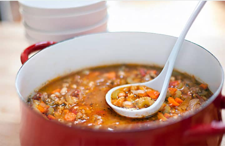 Pasta Fagioli being served from a large pot