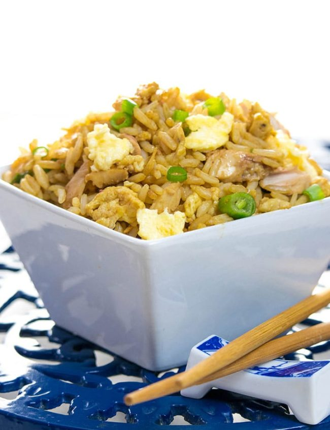 A bowl of best ever fried rice with chop sticks next to it