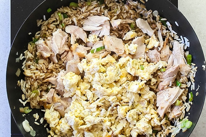 The meat and egg added to the fried rice.
