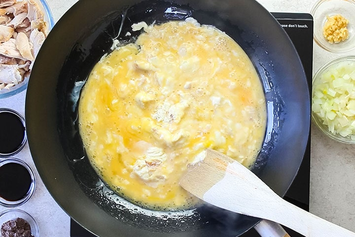 scrambled eggs cooking in a wok