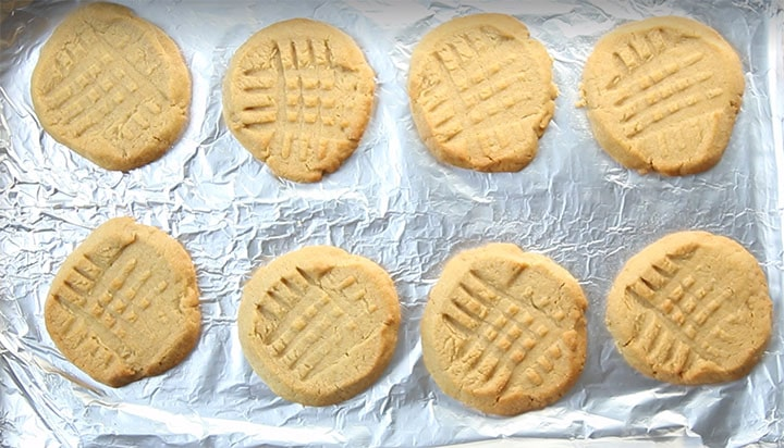 fresh baked Classic Peanut Butter Cookies with golden edges and crisscross pattern