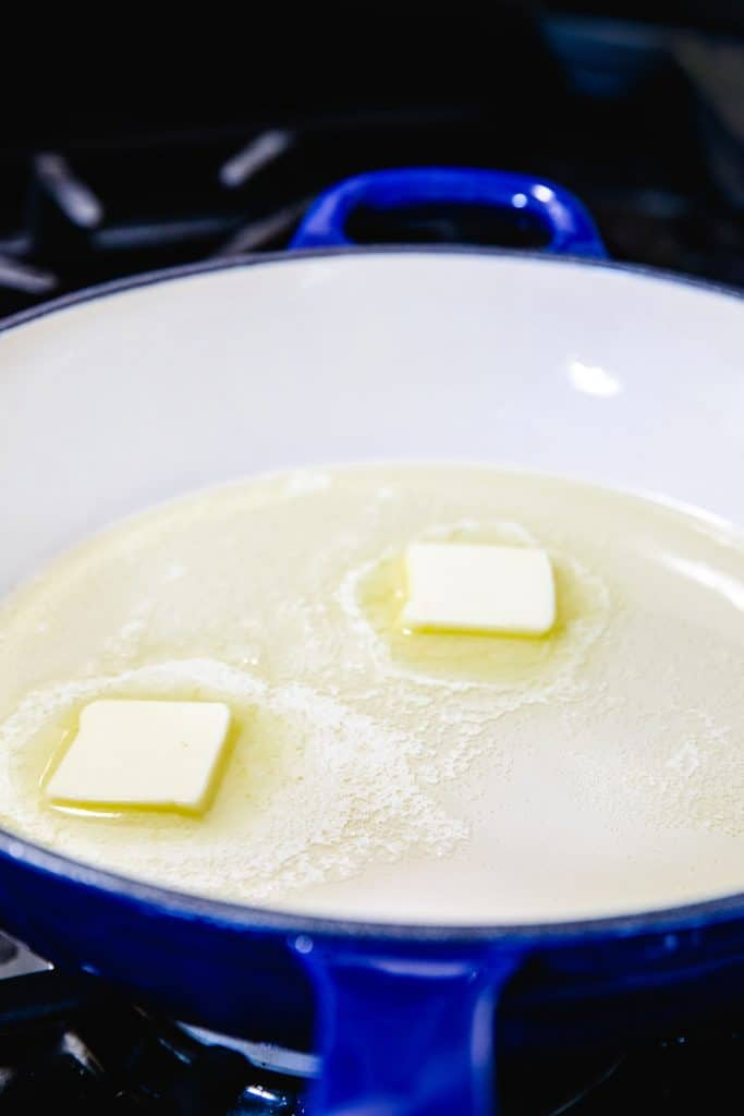 butter and olive oil melting together in a pan
