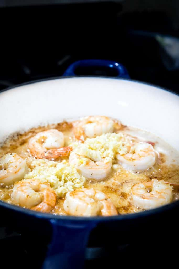 the garlic added to the pan with the shrimp