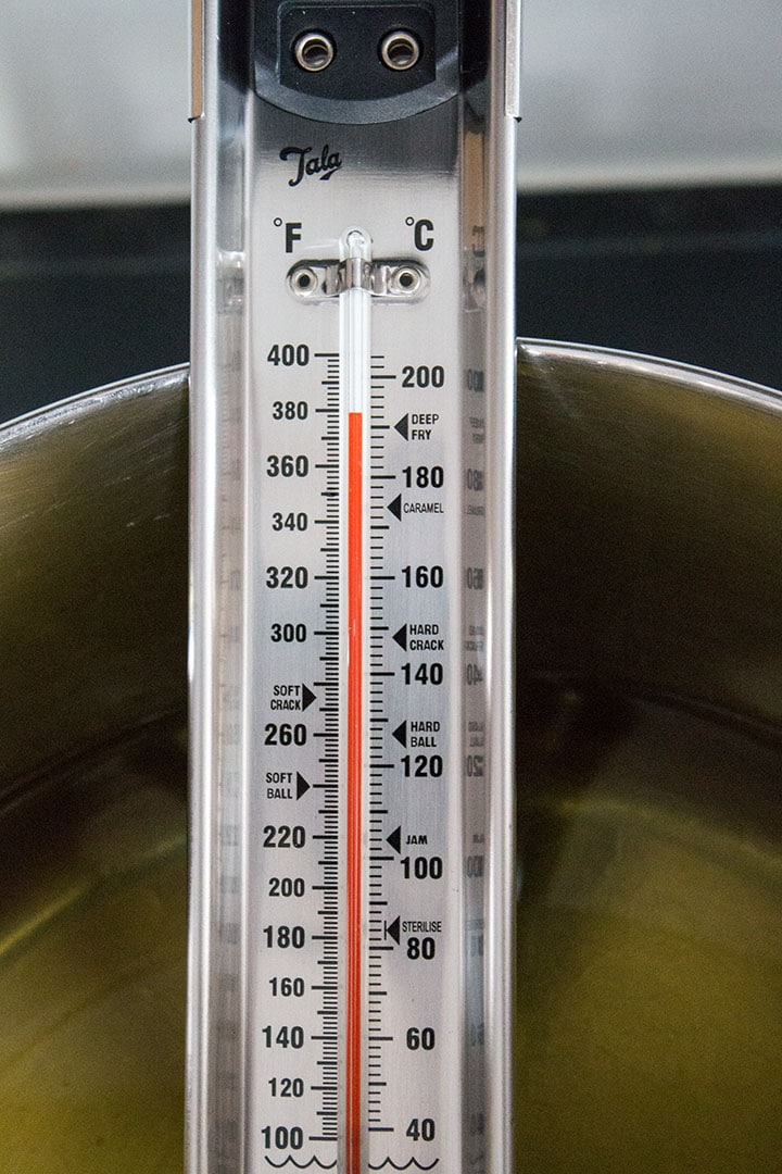 A thermometer in a pot showing 380 degrees Fahrenheit