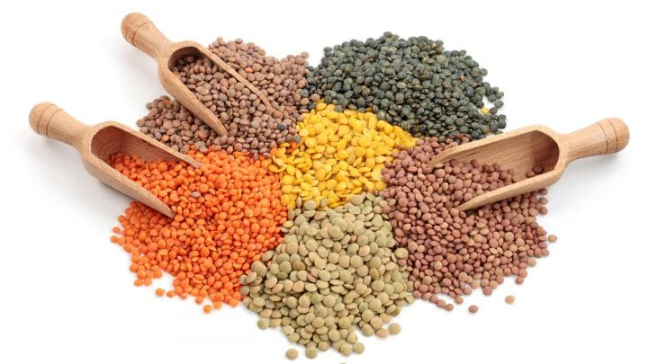 a variety of lentils all piled together