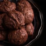 A close up of a Chocolate hazelnut cookies piled on a silver platter