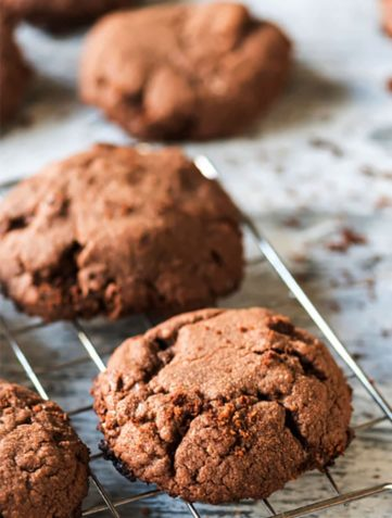 A close up of a Chocolate hazelnut cookies cooling on a cooling rack