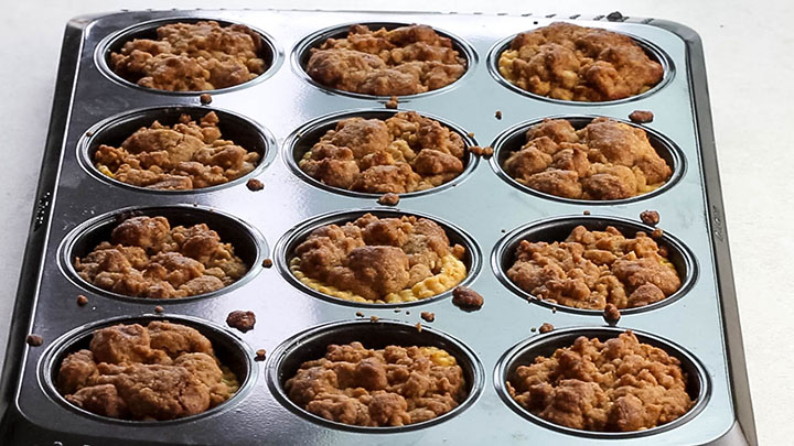 The baked Pumpkin Streusel Tarts still in the pan