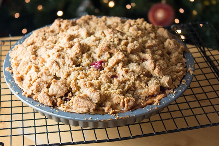 apple cranberry crumb pie cooling on a wire rack