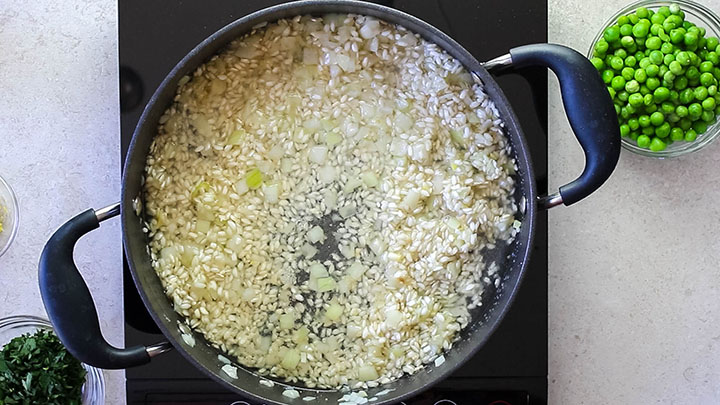 The wine added to the [an with the rice, onions and garlic