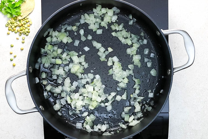 Chopped onions sauteing in olive oil