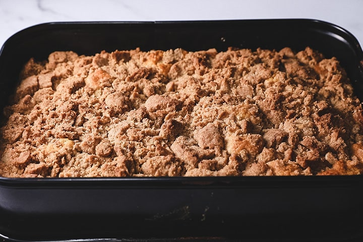 The crumb cake, freshly baked and still in the pan