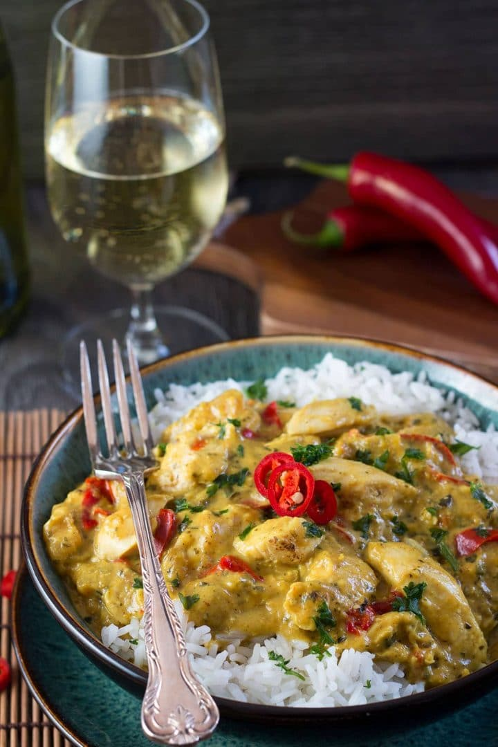Thai Panang Chicken Curry on a bed of steamed rice and garnished with red chillies