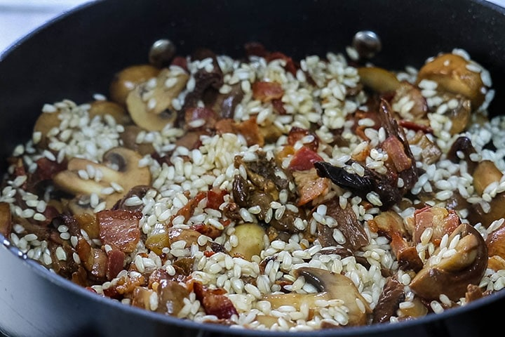 The recipe added to the bacon and mushroom mixture in the pan