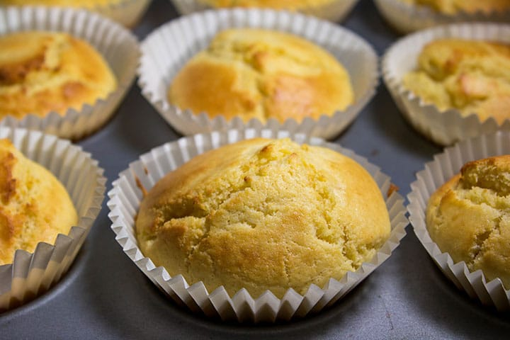Freshly baked, golden corn muffins fresh out of the oven