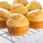 Freshly baked corn muffins cooling on a cooling rack