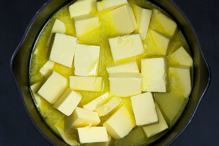 The butter cubes in the pot