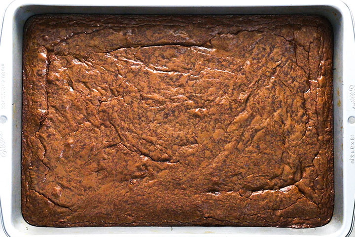 The baked brownies still in the pan