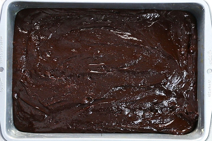 the brownie batter in the pan ready to bake