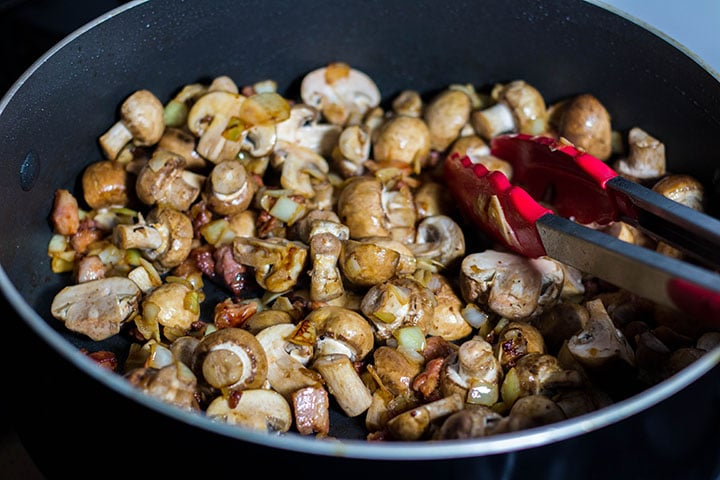 The mushrooms added to the pan with the bacon, onions and garlic