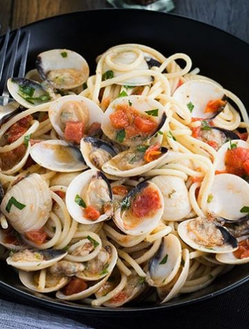 Spaghetti with Clam Sauce in a dish with a fork next to the plate