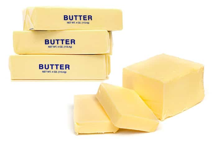 a photo of sticks of butter and a block of butter