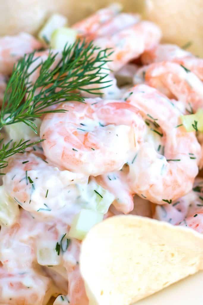 shrimp salad with a lemon wedge and dill garnish