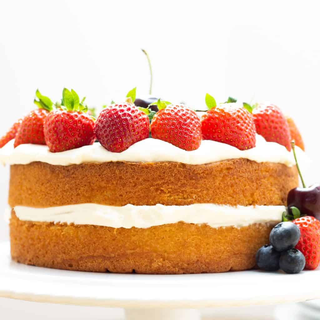 a layer cake topped with fruit