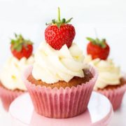 Three fresh strawberry cupcakes a