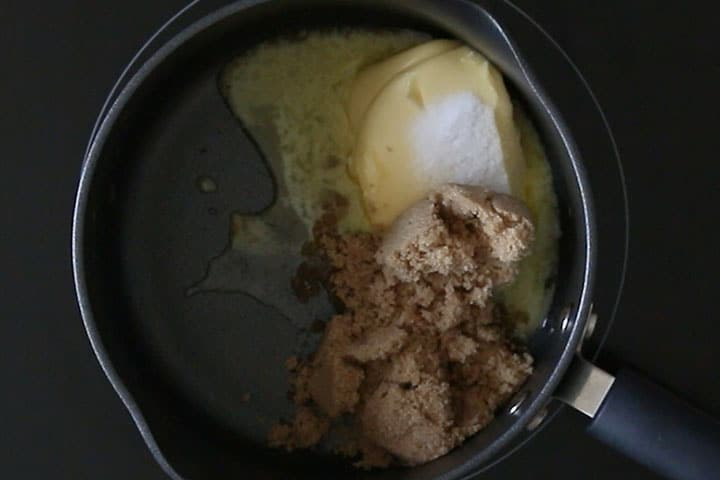 A pot with butter and sugar added to it