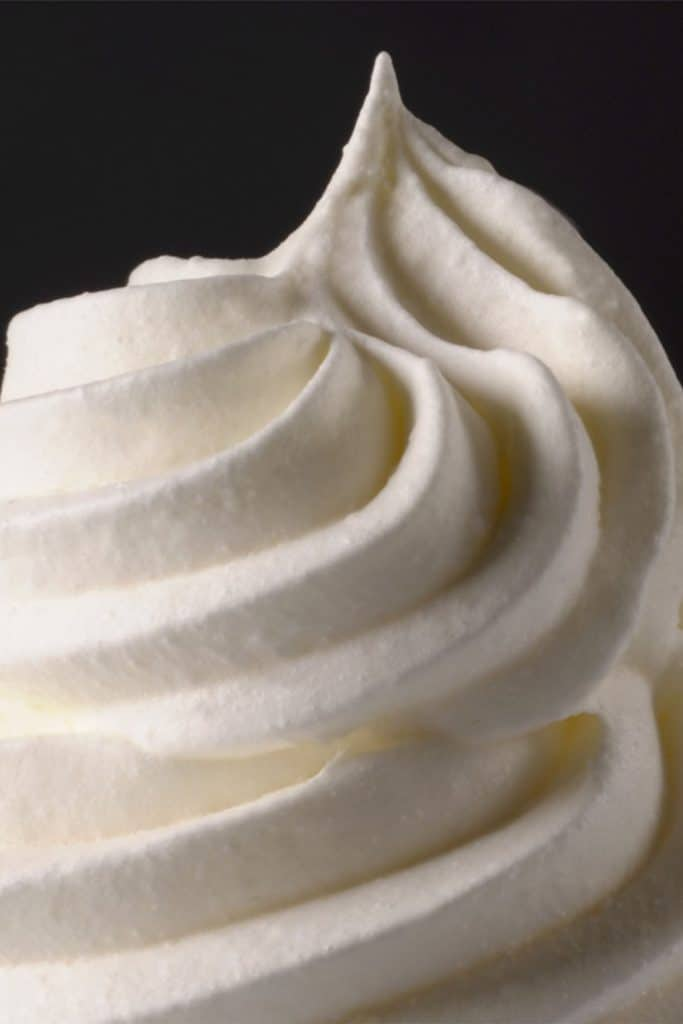 a swirl of whipped cream with a black background