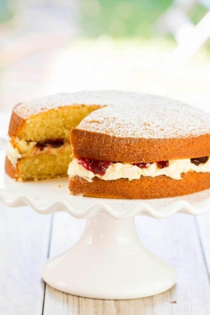 Victoria Sponge Cake with Buttercream with a slice taken out