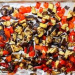 The roasted vegetables on the baking sheet fresh from the oven