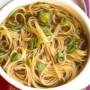 Chinese Noodle Soup in a bowl with sliced green onions on top
