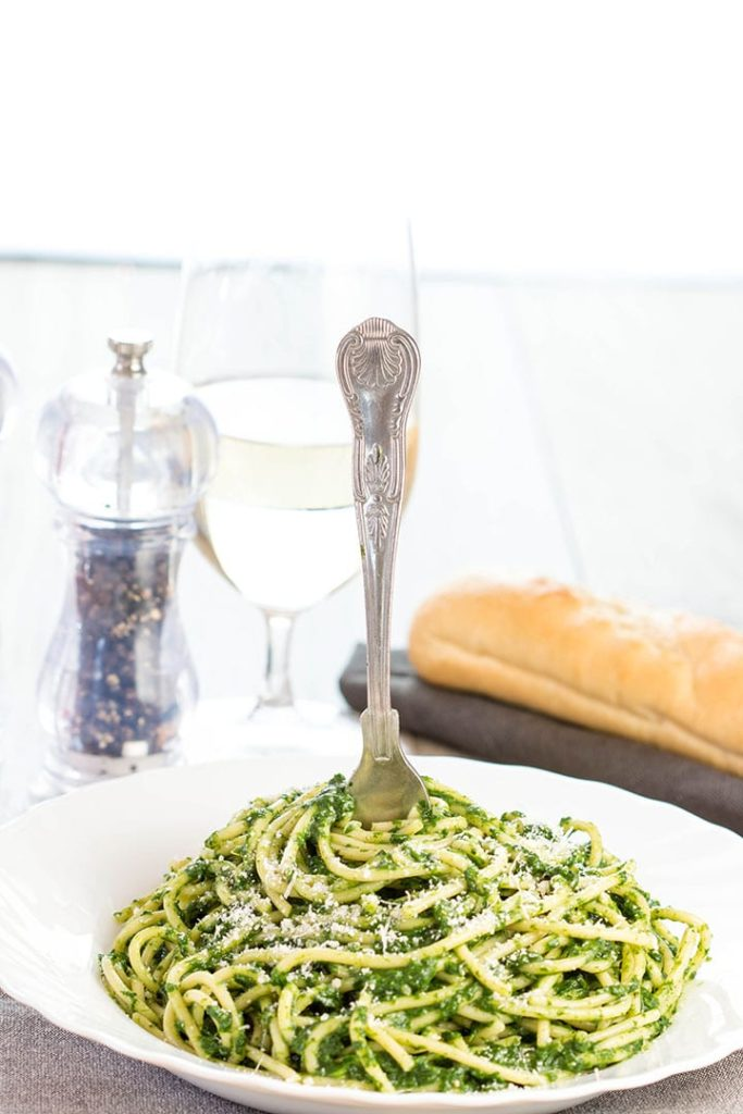 a plate full of Spaghetti with Spinach Sauce