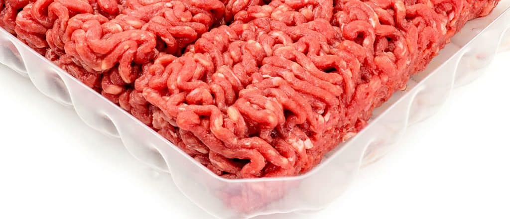 the corner of a pachage of raw ground beef
