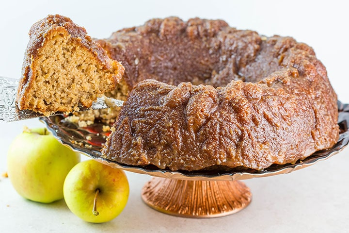 Caramel Apple Bundt Cake being cut and served