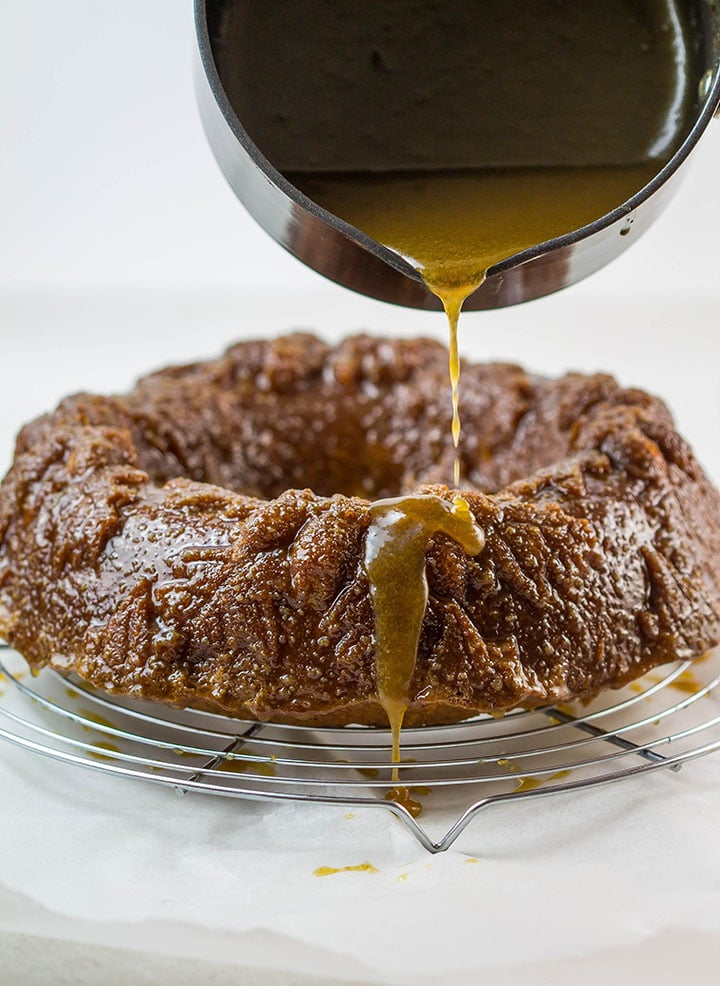 723d25626ce Caramel Apple Bundt Cake with the caramel sauce being poured over it
