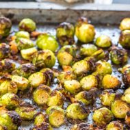 A pan with roasted Brussels Sprouts that have crisp, golden edges