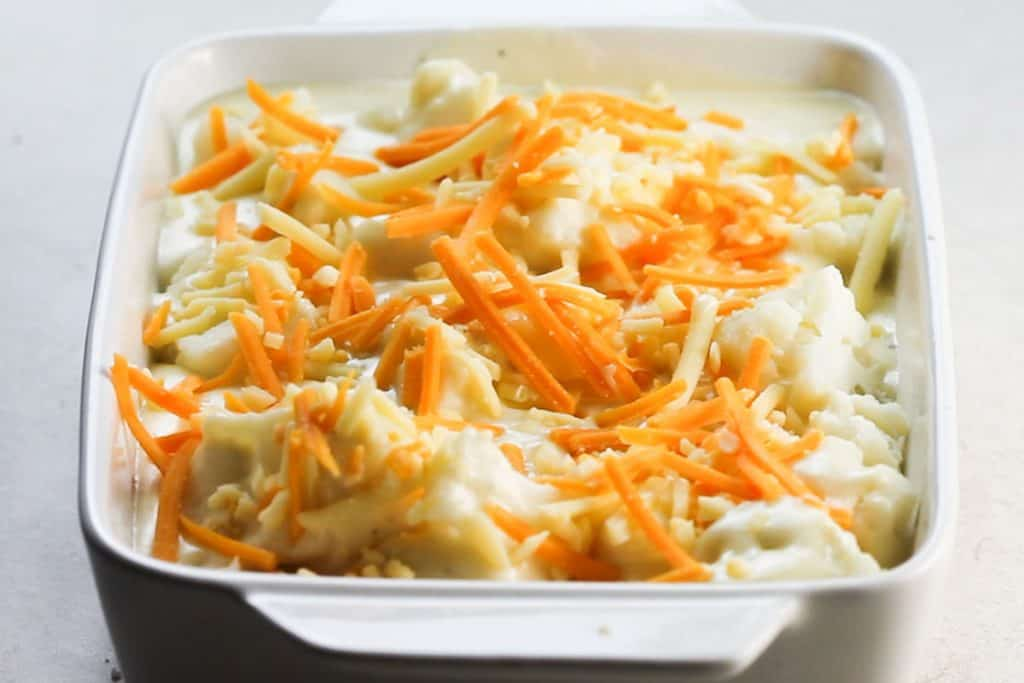 shredded cheese added to the pan with the cauliflower and cheese sauce